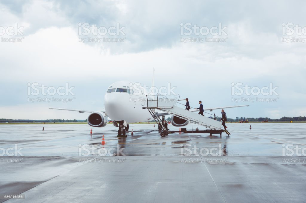 Business people boarding airplane stock photo