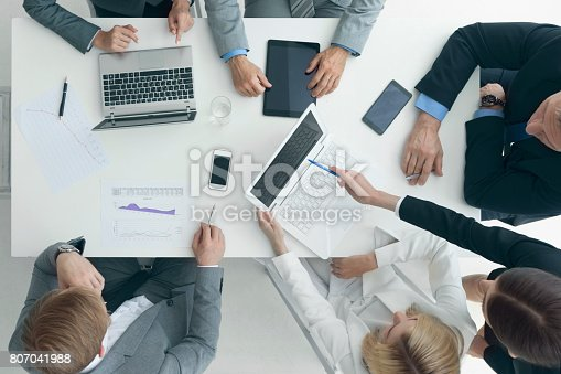 istock Business people brainstorming at office desk 807041988