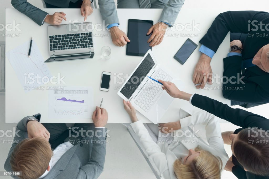 Business people brainstorming at office desk stock photo