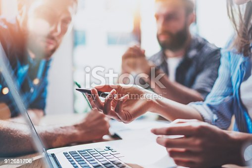 istock Business people brainstorming concept.Coworkers working at office.Closeup view of female hand pointing on laptop screen. Horizontal, flares effect. 912681706