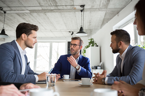 Business People Brainstorming Idea In Meeting Stock Photo - Download Image Now