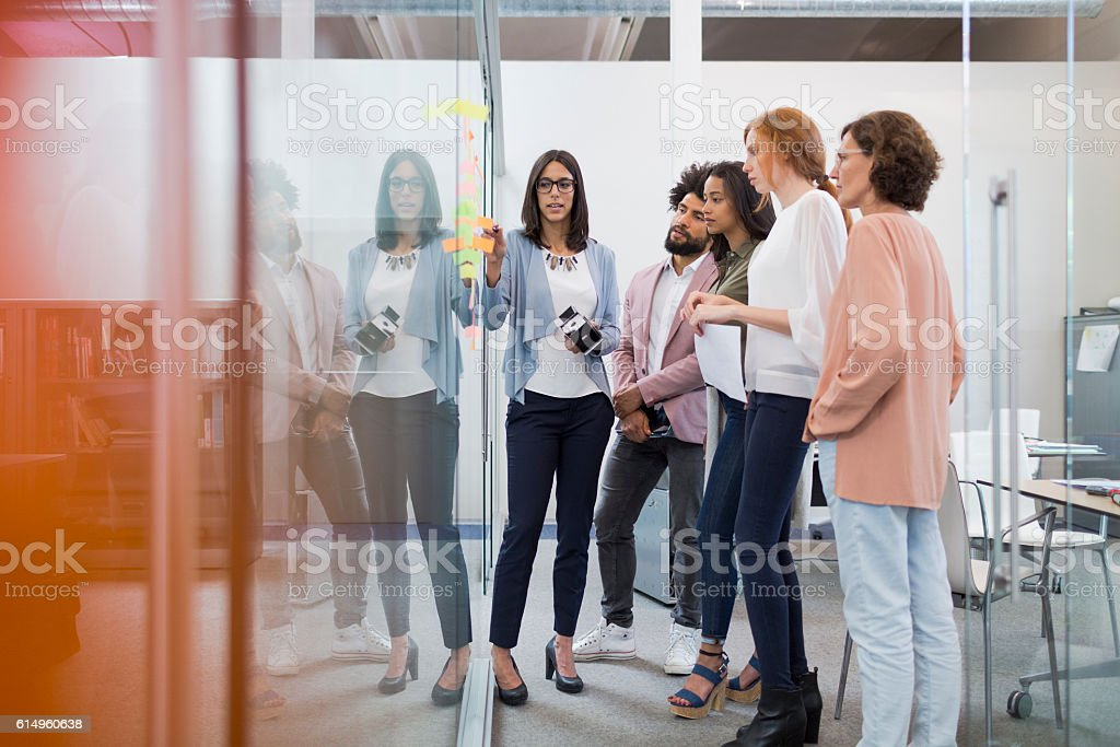 Business people brainstorming in conference room. stock photo
