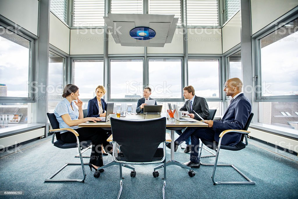 Business people brainstorming in conference room stock photo
