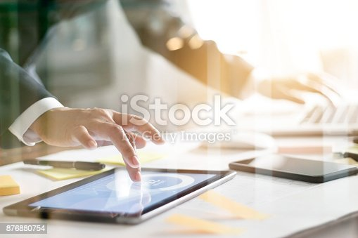 istock Business people busy working the charts and graphs showing in the tablet and laptop of successful in office background 876880754