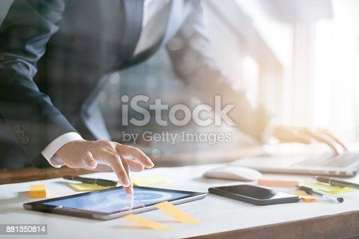 istock Business people busy working the charts and graphs showing in the tablet and laptop of successful in office background 881350814