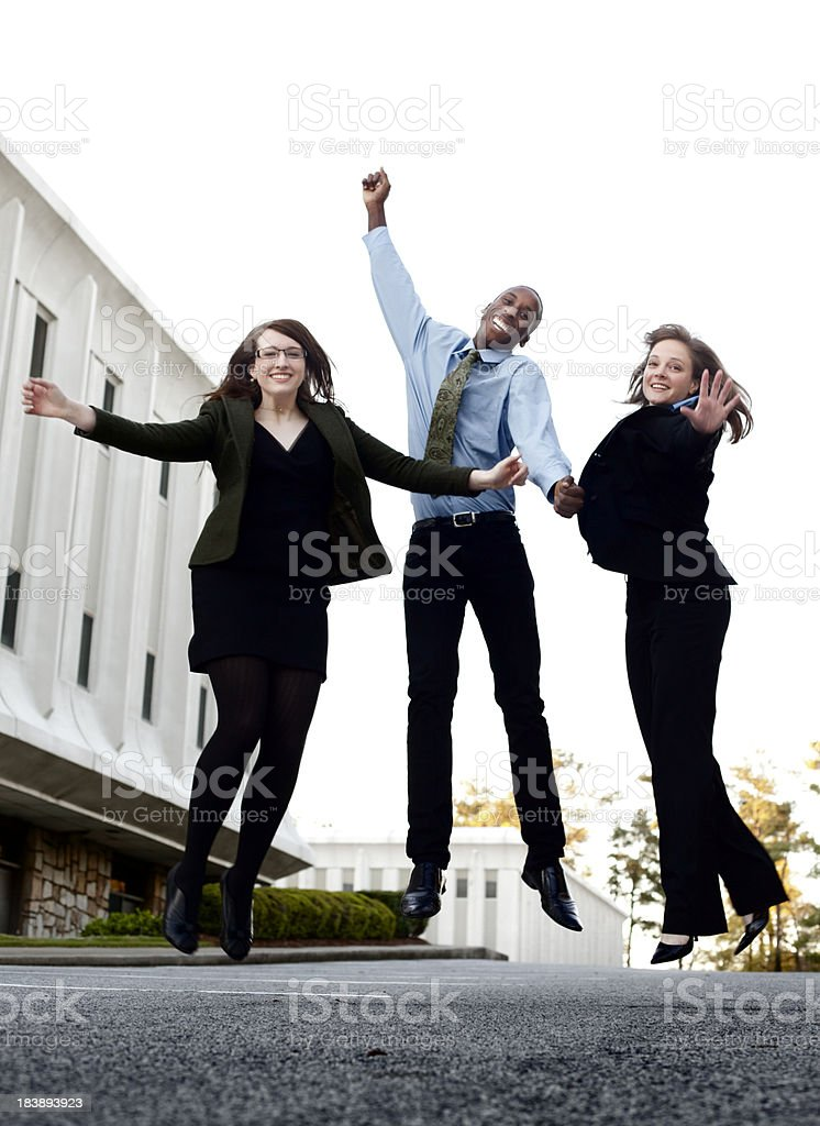 Business people celebrating by jumping in the air royalty-free stock photo