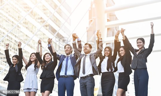 istock Business People Celebrating with arm raised up. 825822786