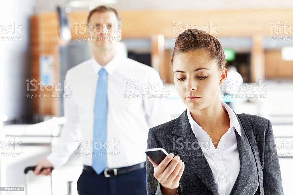 Business People Checking In At Airport royalty-free stock photo
