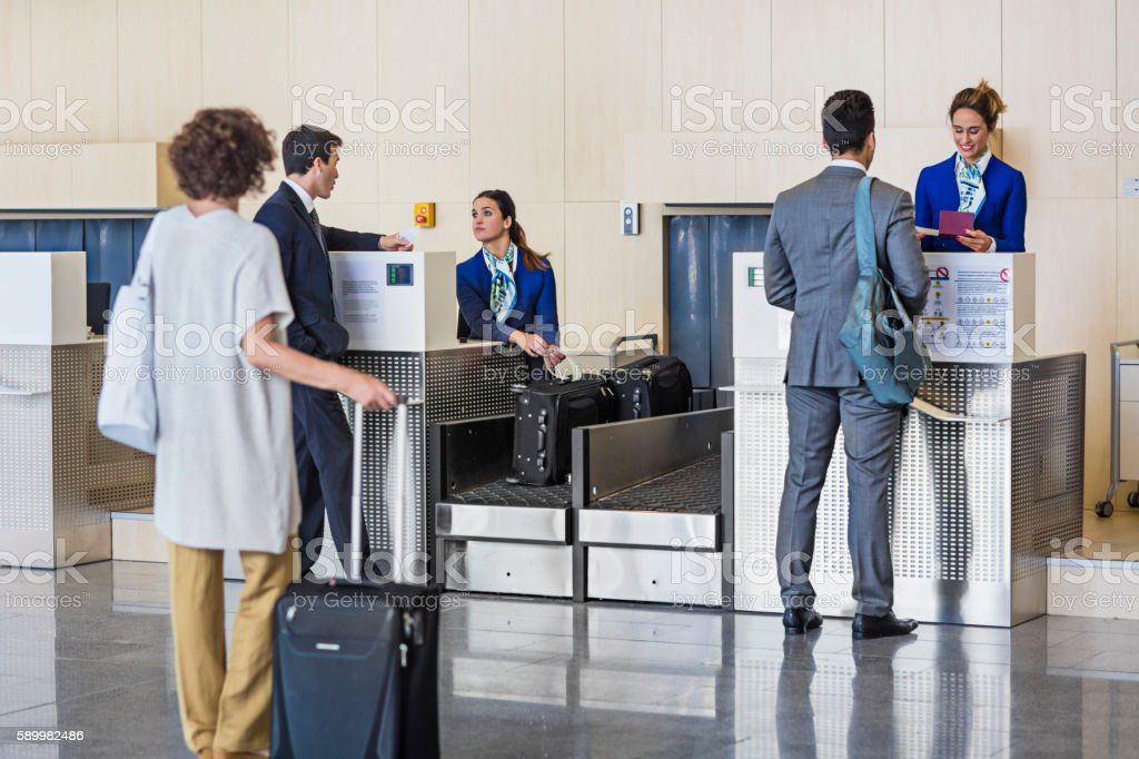 Business people checking in at the airport stock photo
