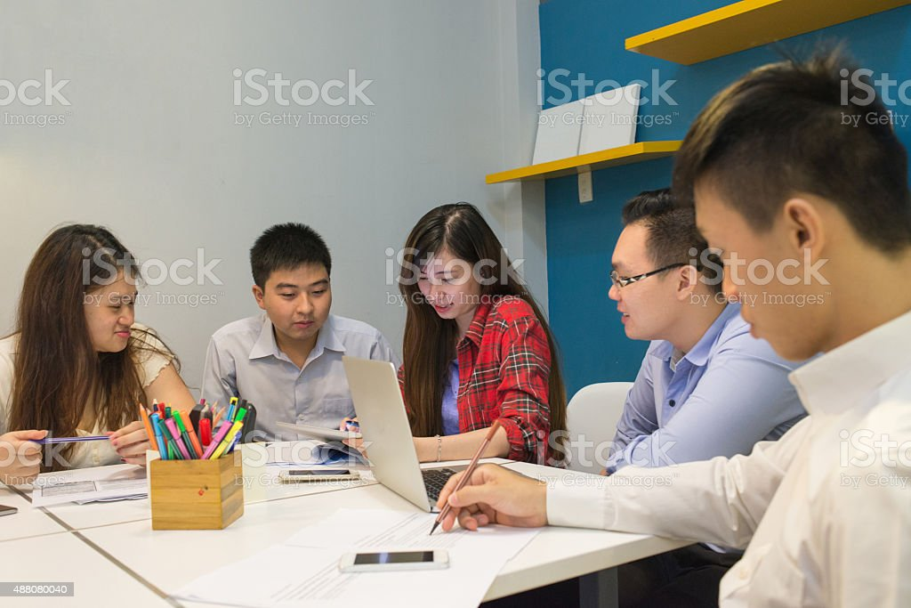Business people checking new information in the tablet stock photo