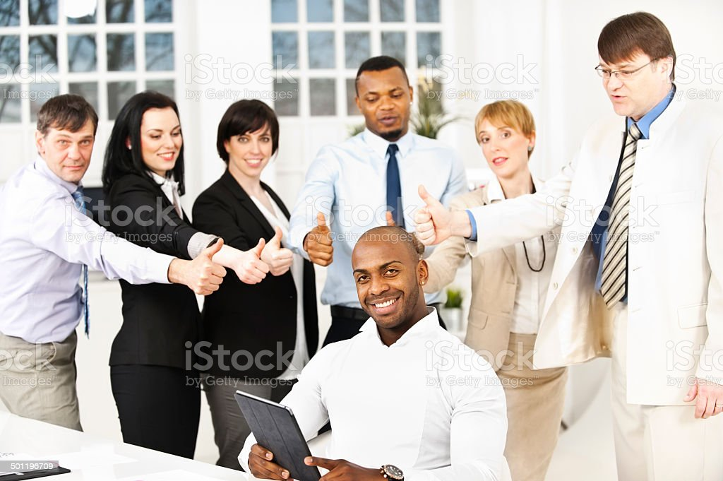 Business people cheering in the office stock photo