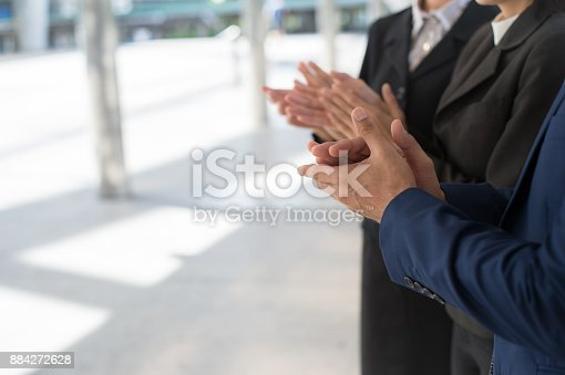 924520168 istock photo business people clap their hands to congratulate the signing of an agreement or contract between their firms, companies, enterprises. success, dealing, greeting and partner concept. and copy space for text 884272628