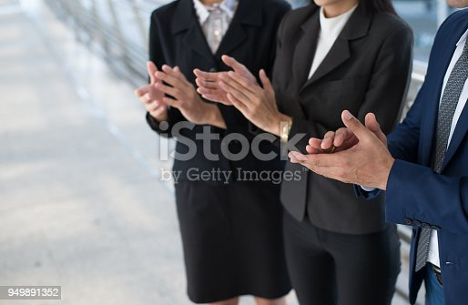 924520168 istock photo business people clap their hands to congratulate the signing of an agreement or contract between their firms, companies, enterprises. success, dealing, greeting and partner concept. and copy space for text 949891352