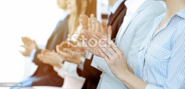 1153898364 istock photo Business people clapping and applause at meeting or conference, close-up of hands. Group of unknown businessmen and women in modern white office. Success teamwork or corporate coaching concept. 1158602784