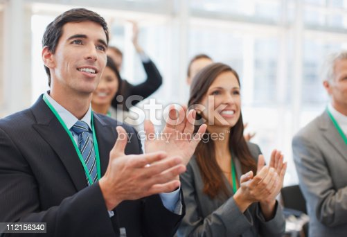 112156285 istock photo Business people clapping at seminar in office 112156340