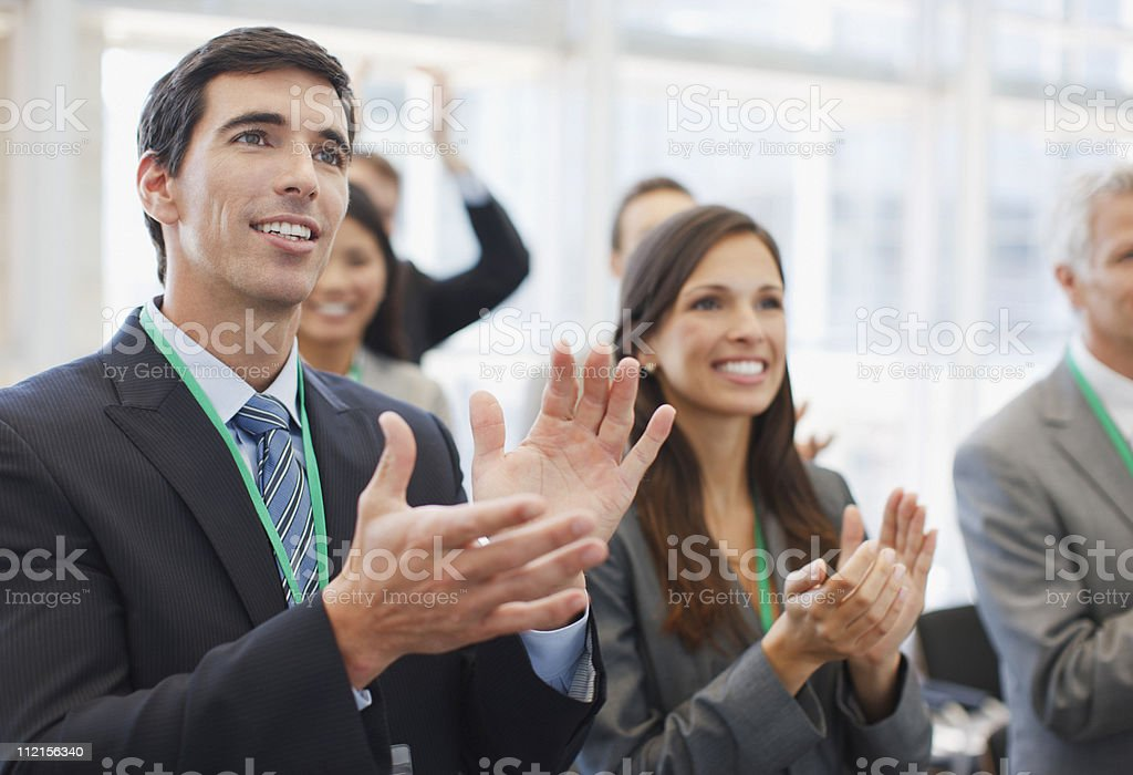 Business people clapping at seminar in office stock photo