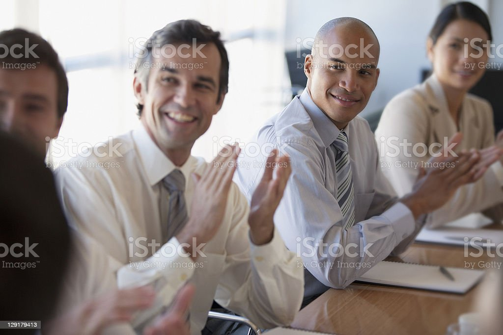 Business people clapping during a meeting royalty-free stock photo