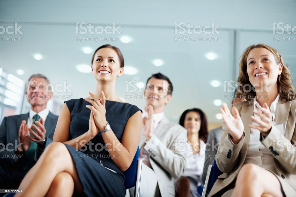 Business people clapping for a good presentation in boardroom royalty-free stock photo
