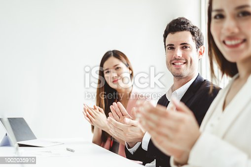 istock Business people clapping hands during meeting in office for their success in business work 1002035910