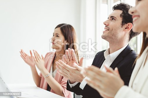 istock Business people clapping hands during meeting in office for their success in business work 1008909332