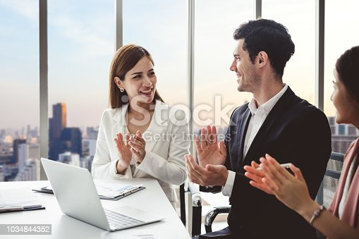 istock Business people clapping hands during meeting in office for their success in business work 1034844352