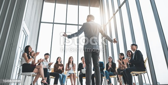istock Business people clapping hands during meeting in office for their success in business work 1049824998