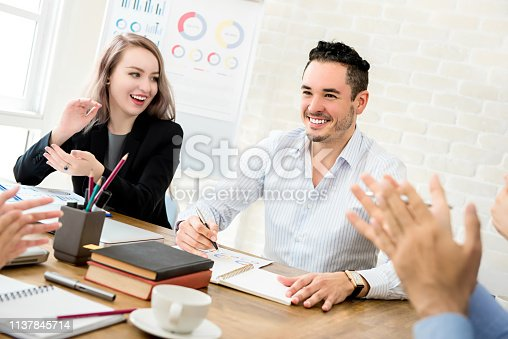 924520168 istock photo Business people clapping hands to congratulate  their colleague at the meeting 1137845714