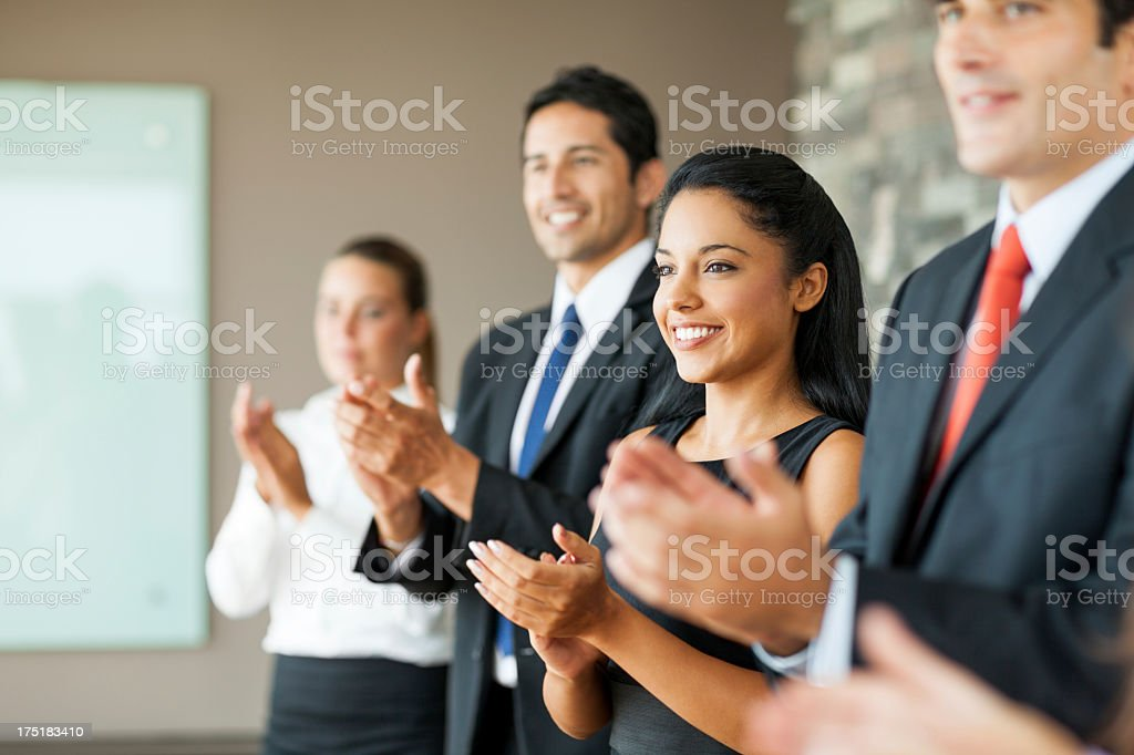 Business people clapping in a meeting royalty-free stock photo