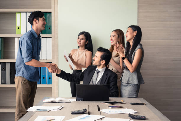 business people clapping in office after signing agreement, Achievement, congratulation and appreciation concept stock photo