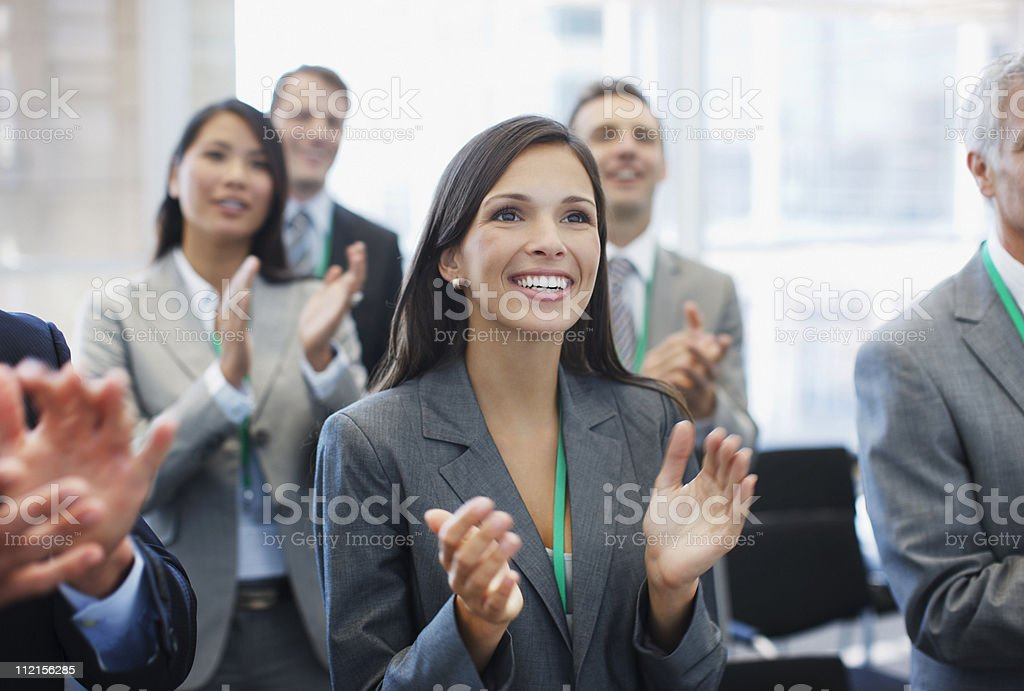 Business people clapping in seminar stock photo