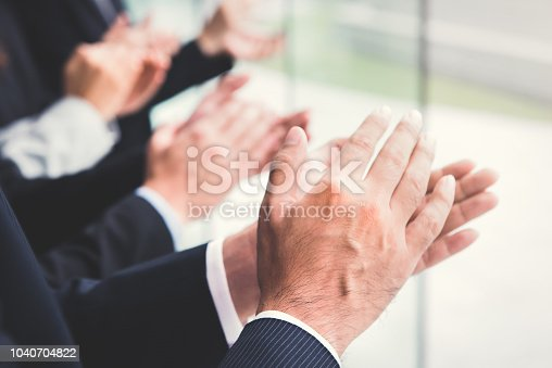 924520168 istock photo Business people  clapping their hands 1040704822
