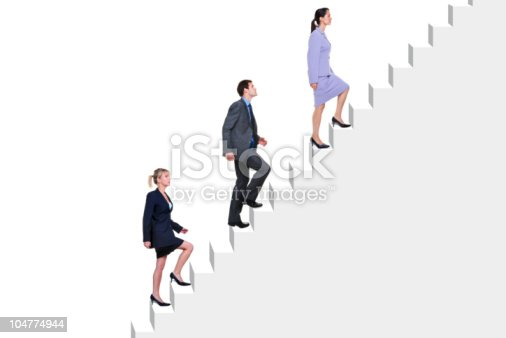 84743203 istock photo Business people climbing stairs 104774944