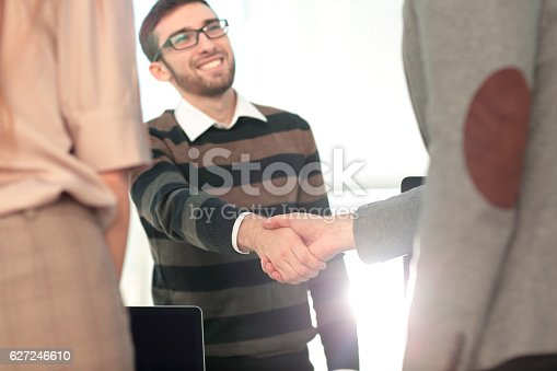 istock Business people closing a deal and handshaking at the office 627246610