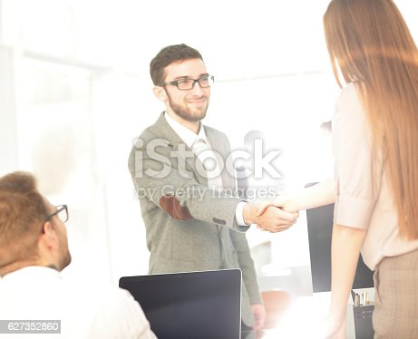 istock Business people closing a deal and handshaking at the office 627352860