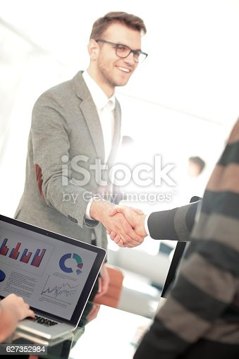 528606286 istock photo Business people closing a deal and handshaking at the office 627352984