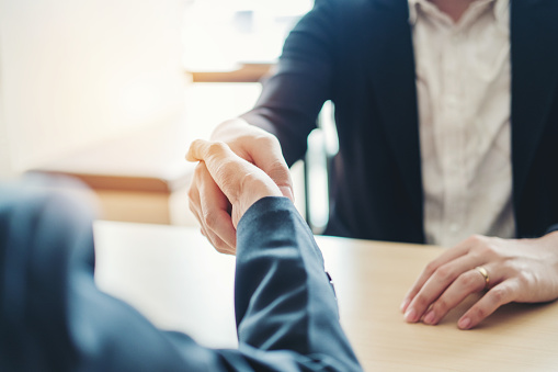 656005826 istock photo Business people colleagues shaking hands meeting Planning Strategy Analysis Concept 1012329034