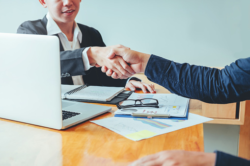 656005826 istock photo Business people colleagues shaking hands meeting Planning Strategy Analysis Concept 1012329126
