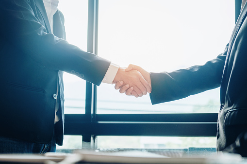 656005826 istock photo Business people colleagues shaking hands meeting Planning Strategy Analysis Concept 1012329138