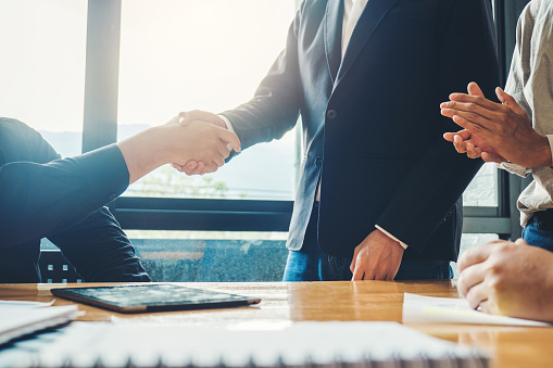 656005826 istock photo Business people colleagues shaking hands meeting Planning Strategy Analysis Concept 1012329146