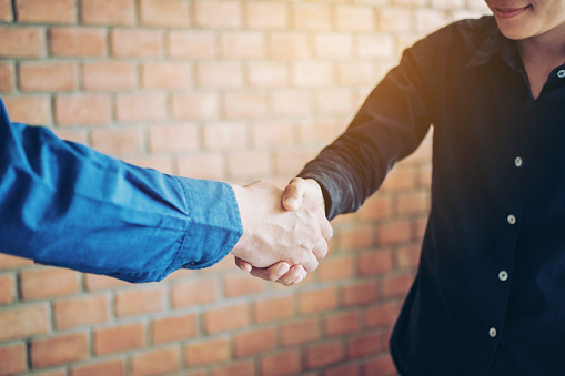 656005826 istock photo Business people colleagues shaking hands meeting Planning Strategy Analysis Concept 937138654