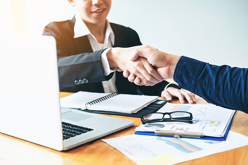 656005826 istock photo Business people colleagues shaking hands meeting Planning Strategy Analysis Concept 952659880