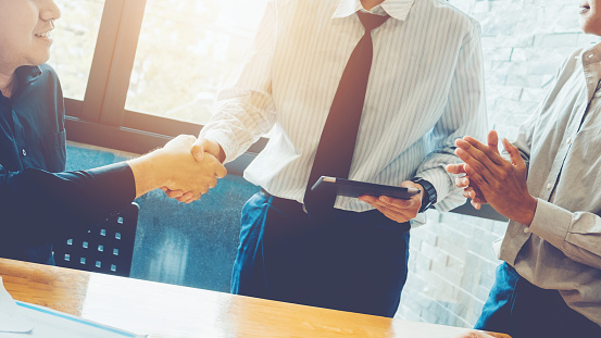 656005826 istock photo Business people colleagues shaking hands meeting Planning Strategy Analysis Concept 952662004