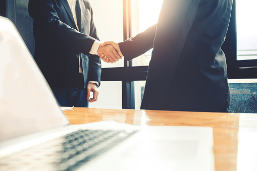 656005826 istock photo Business people colleagues shaking hands meeting Planning Strategy Analysis Concept 971227344