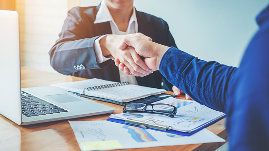656005826 istock photo Business people colleagues shaking hands meeting Planning Strategy Analysis Concept 998227082