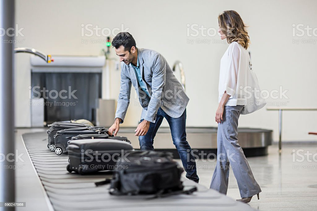 Business people collecting their luggage stock photo