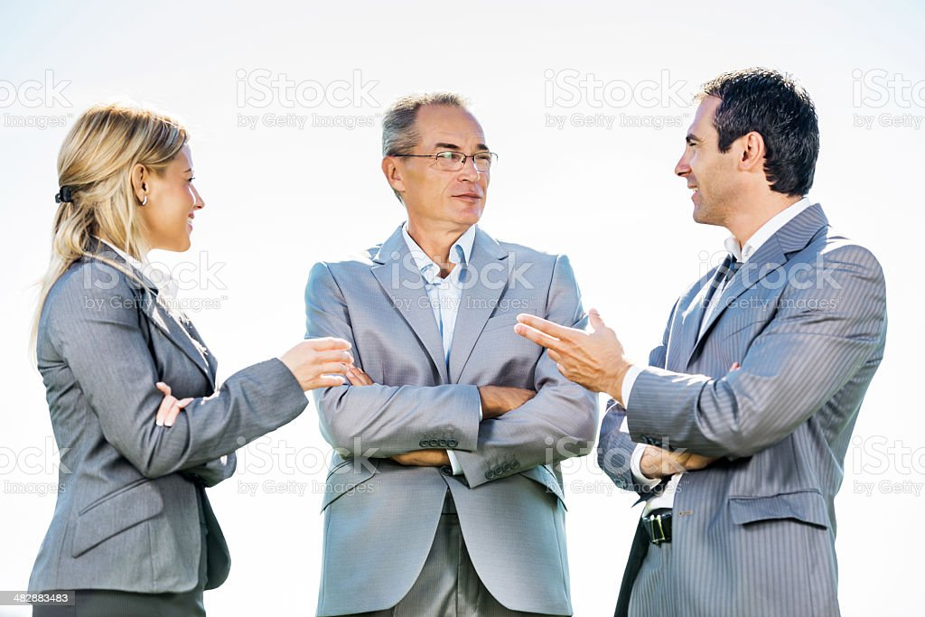 Business people communicating outdoors. royalty-free stock photo