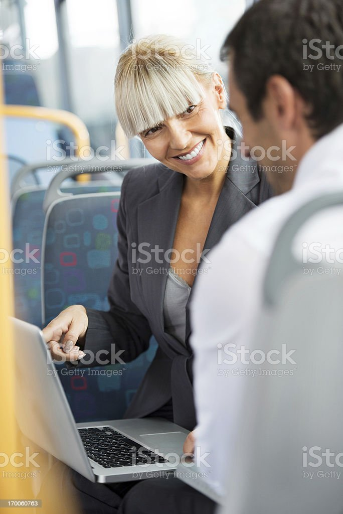 Business people communicating while commuting to work. royalty-free stock photo