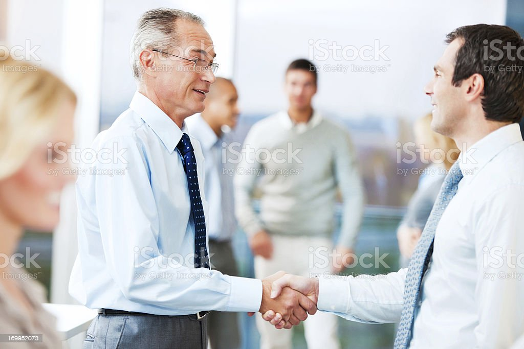 Business people congratulating each other. royalty-free stock photo