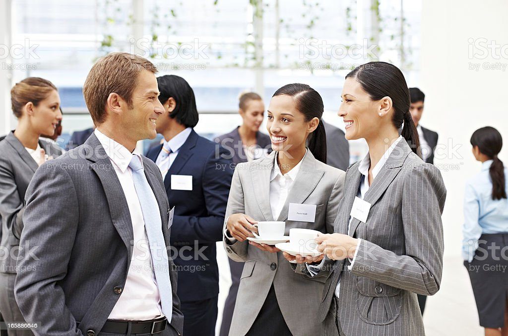 Business People Conversing at a Conference stock photo
