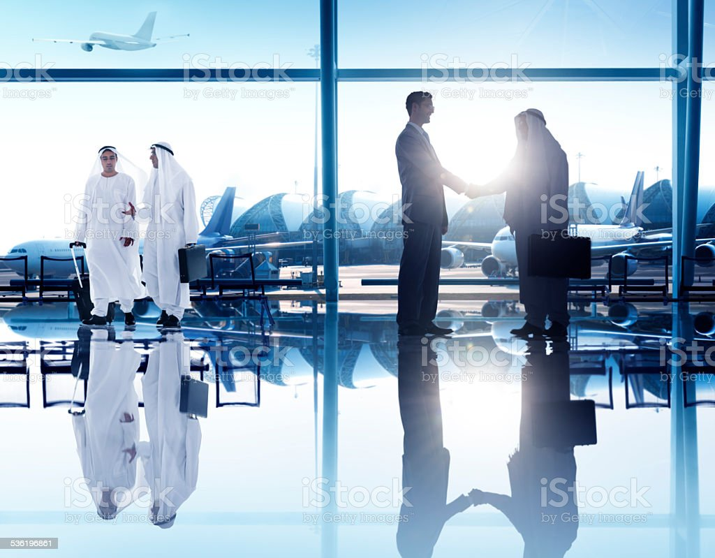 Business People Corporate Handshake Airport Concept stock photo